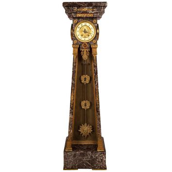 Empire Style Clock in a Marble Tapering Pedestal with a Sunburst Pendulum