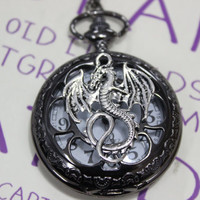 The black pocket watch with the magic silver dragon image