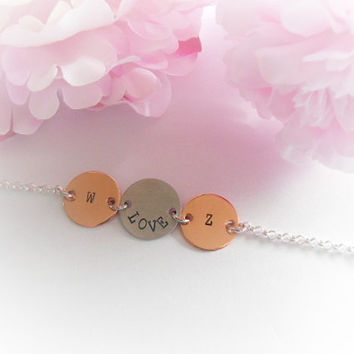 Hand Stamped Copper And Aluminium Disc Bracelet Love Initials