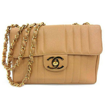 Vintage CHANEL beige 2.55 jumbo caviar leather large shoulder bag with golden CC Vertical, chevron stitch. Classic caviar leather