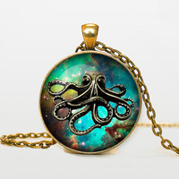 Steampunk octopus on the nebula pendant by RainforestNecklaces