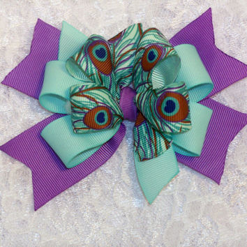 Unique purple spikes sky blue multicolored peacock feather design double stacked 4 X 3.5 hair bow with on a lined alligator clip