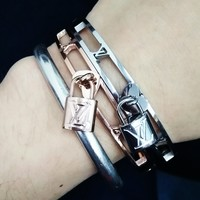 LV Louis Vuitton New Fashion Classic Lock Hollow Stainless Steel Personality Jewelry Accessories Bracelet Women