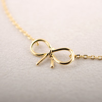 Bow Bracelet Available in Silver or Gold