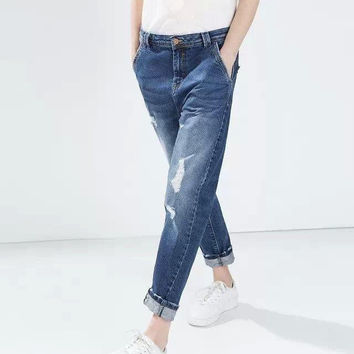 Blue Denim Ripped And Frayed Jeans