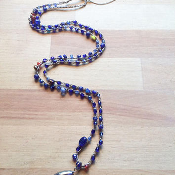 Long sparkly beaded crochet urban gypsy boho necklace with faceted blue Czech glass beads.