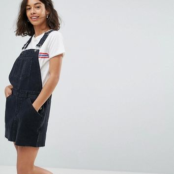ASOS PETITE Denim Overall Dress in Washed Black at asos.com