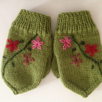 Hand knitted toddler girl mittens with thumb 2-3 years olds, wool yarn light green color with flowers. Winter outfit for toddler .