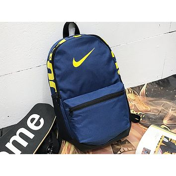 NIKE sells casual men's and women's shopping bags with fashionable printed stitching backpacks Dark Blue