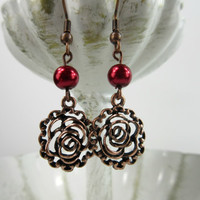 Rose Earrings in rose copper tone with deep red glass pearls
