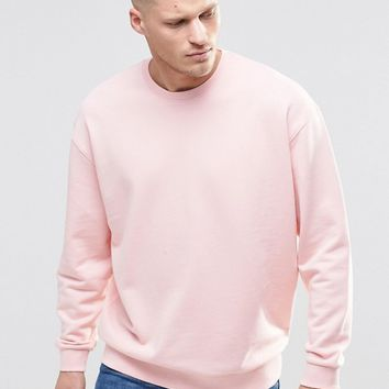 ASOS Oversized Sweatshirt In Pink at asos.com