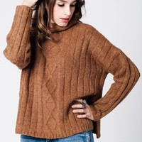 Orange sweater in soft knit with side slits and turtle neckline