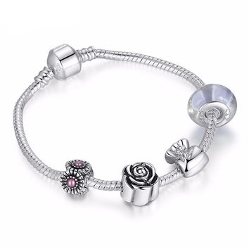 Elegant Silver Charm with Murano Glass Bead Bracelet