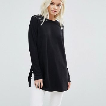 ASOS PETITE Top In Textured Rib With Long Sleeves and Side Splits at asos.com