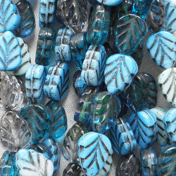 Lot of 25 Czech glass leaf beads, blue mix with black picasso accents, opaque and transparent center drilled 8 x 10mm beads C05101