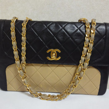 Vintage CHANEL black and beige color lambskin 2.55 style shoulder bag with gold tone chain straps. Rare vintage bag from CHANEL in the 80's.