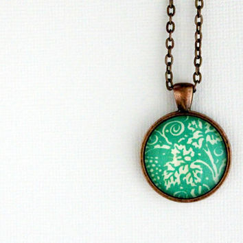 Green grape vine necklace made with vintage sheet music illustration.  Antiqued copper pendant with domed glass.