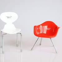 Two vintage miniature design chairs, miniature white Arne Jacobson ant chair, red miniature Eames chair, retro doll house furniture