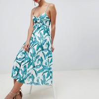 ASOS DESIGN knot front pleated midi dress in palm print at asos.com