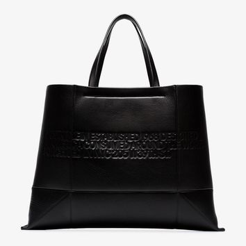 black geometric embossed leather tote