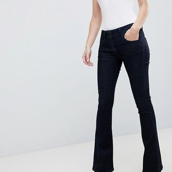 ASOS DESIGN Super Low Rise Flared Jeans In Indigo at asos.com