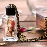 Handmade real flower necklace. Dried flower bottle necklace. Spring necklace with bronze bird. Romantic bottle necklace. Spring gift for her