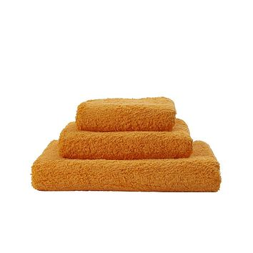 Super Pile Orange Towels by Abyss and Habidecor