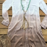 Our You Could Be Mine Shirt Dress - Mocha would be so cute for any occasion! It's a long sleeve shirt dress that has a crepe like texture and appearance. Very sheer and unlined. Tie dye ombre effect. Also has pockets. We recommend wearing with a cami for