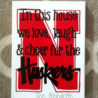Nebraska Corn Huskers. Huskers. In this house we love, laugh, and cheer for the Huskers. Nebraska. 9 x 12 inch canvas