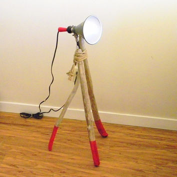 Vintage Smith Victor stage light mounted on driftwood tripod illuminating your living room