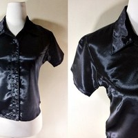 Black Button Down Shirt: blouse, glossy, leathery