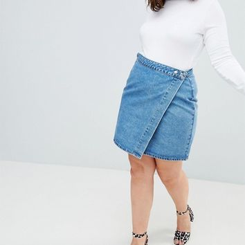ASOS DESIGN Curve denim wrap skirt in stonewash blue at asos.com