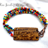 Wood and seed bead glass with metal bracelet.