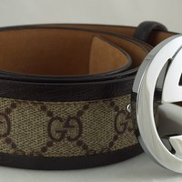 Gucci Brown Trim & Monogram Belt. Comes with Belt and Dustbag. USED