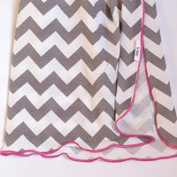 Girl baby swaddler. Chevron printed fabric. Blanket size: Size 31 by 40 inches. Colors- White and gray with pink edging.