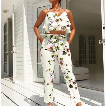 Floral White Flounced Vest Top and Slim Belt Pants
