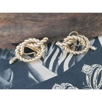 Napier signed gold toned knotted clip on vintage earrings