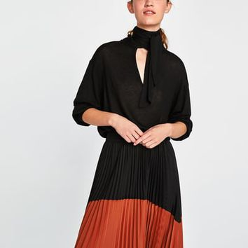 TWO-TONE PLEATED SKIRT