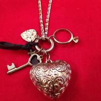 Love Charm Necklace with two hearts, an engagement ring, a key and a black ribbon - Valentines Day
