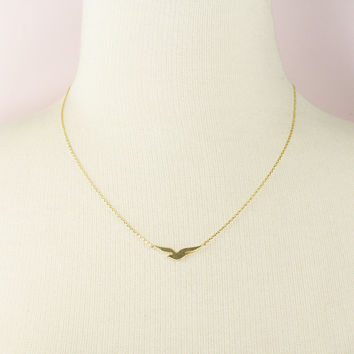 Tiny Gold Seagull Charm Necklace .
