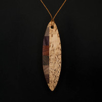 Surf shaped necklace pendant amulet. Different kinds of wood. Unique handmade jewelry. Sport, surf geek style