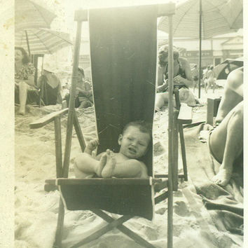 Not as Comfortable As It Looks Baby Boy Sitting in Cloth Beach Chair Summer Vacation 1940s Vintage Black and White Photo Photograph