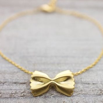 Farfalle pasta ribbon gold bracelet with an adjustable extension chain