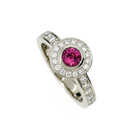 Pink tourmaline halo engagement ring made from white gold, diamond, bezel, solitaire, custom, pink tourmaline, pink halo ring, unique ring