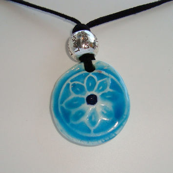 OOAK ceramic turquoise daisy necklace with collectable Brighton™ bead on black  faux-suede flat cotton cord with silver crab-claw closure.