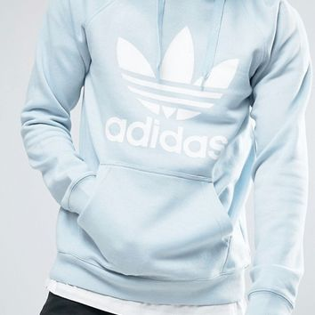 adidas Originals Trefoil Logo Hoodie In Blue BQ5410 at asos.com