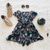 A Floral Ruffle Romper in Navy