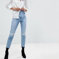 ASOS DESIGN Farleigh high waist slim mom jeans in light vintage wash with busted knee and rip & repair detail at asos.com