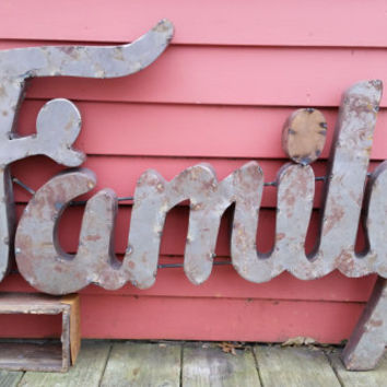 FAMILY sign made from recycled tin metal in cur...