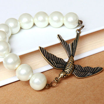 pearl mix vintage pendant bracelet with a flying bird by Sevinoma